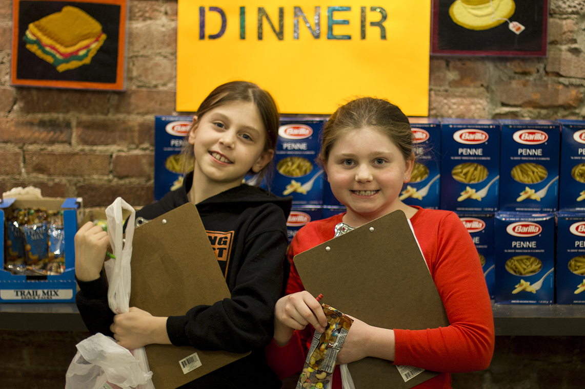 Kids volunteer to pack the pantry at Citymeals